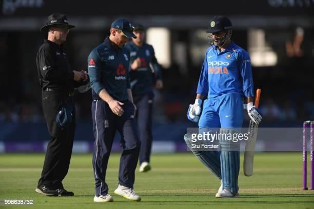 India batsman MS Dhoni wanders off after being dismissed during the 2nd ODI Royal London One Day International match between England and India at...
