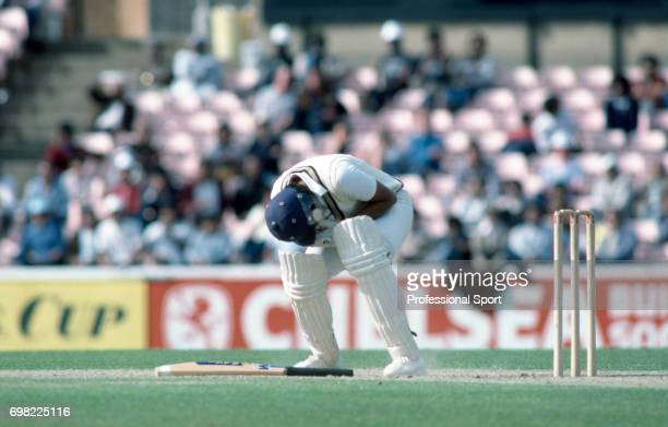 India batsman Dilip Vengsarkar is struck by a delivery from West Indies bowler Malcolm Marshall and has to retire hurt during the Prudential World...