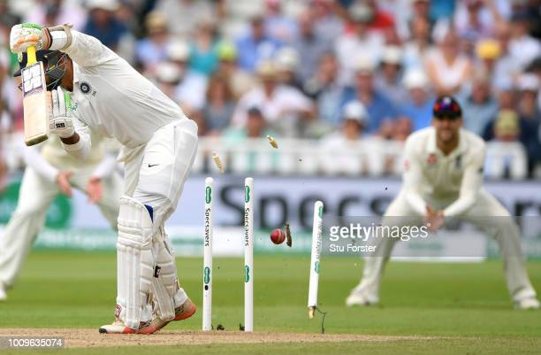 India batsman Dinesh Karthik is bowled by Ben Stokes during day two of the First Specsavers Test Match between England and India at Edgbaston on...