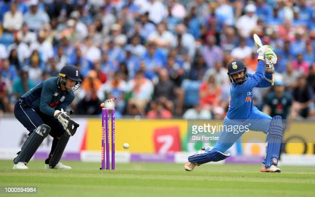 India batsman Dinesh Karthik is bowled by Rashid as Jos Buttler looks on during 3rd ODI Royal London One Day match between England and India at...