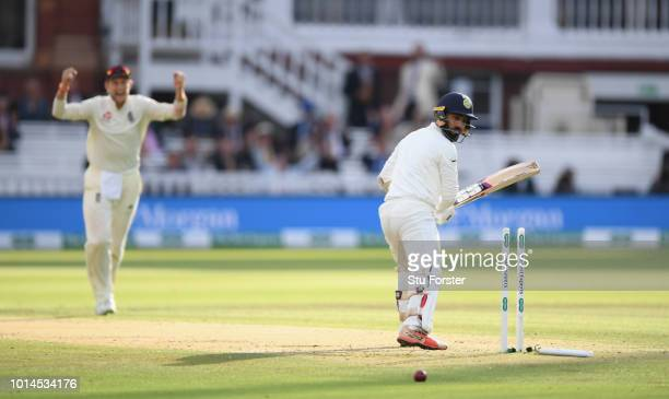 India batsman Dinesh Karthik looks on after being bowled by Sam Curran during day two of the 2nd Specsavers Test Match between England and India at...
