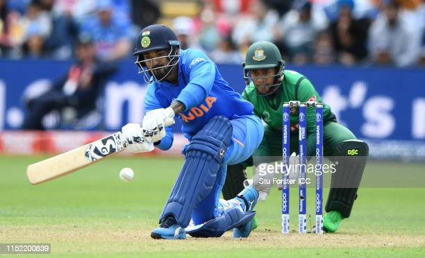 India batsman K L Rahul hits out watched by wicketkeeper Mushfiqur Rahim during the ICC Cricket World Cup 2019 Warm Up match between Bangladesh and...