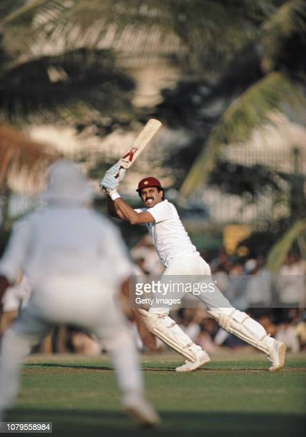 India batsman Kapil Dev hits out during a match against the England touring team on their tour of India 1984/85