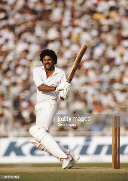 India batsman Kapil Dev pulls a ball during a Nehru Cup match against West Indies on October 23, 1989 in Delhi, India.
