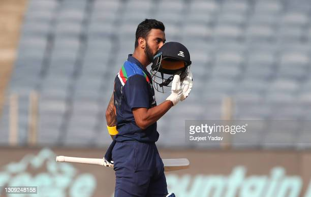 India batsman KL Rahul celebrates after reaching his century during the 2nd One Day International between India and England at MCA Stadium on March...