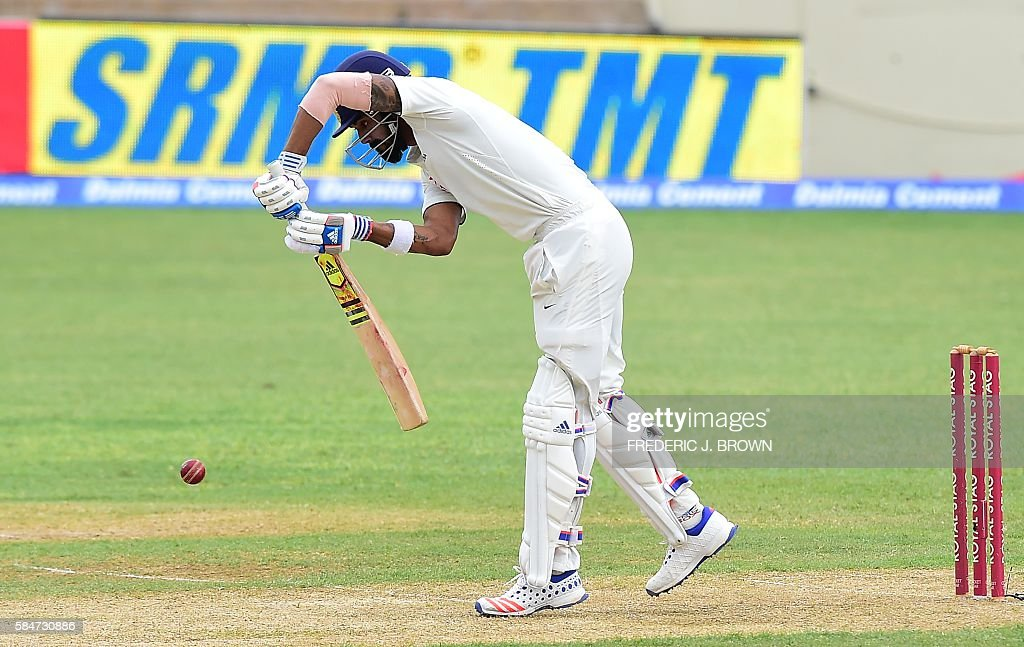 India batsman Lokesh Rahul plays a shot off a delivery from West Indies bowler Jason Holder on July 30, 2016 in Kingston, Jamaica on the first day of the 2nd Test between India and the West Indies. / AFP / Frederic J. BROWN