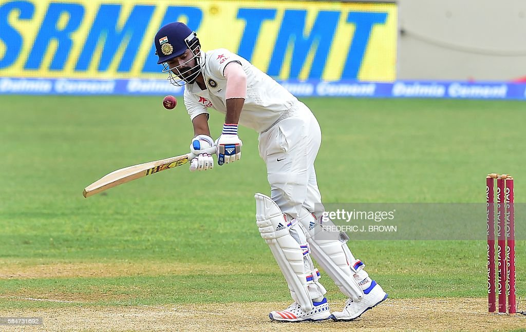 India batsman Lokesh Rahul plays a shot off a delivery from West Indies bowler Jason Holder in the 10th over on July 30, 2016 in Kingston, Jamaica on the first day of the 2nd Test between India and the West Indies. / AFP / Frederic J. BROWN