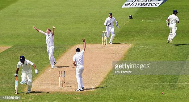 India batsman Mahendra Singh Dhoni is run out by a direct hit from James Anderson as bowler Ben Stokes celebrates during day two of the 1st Investec...