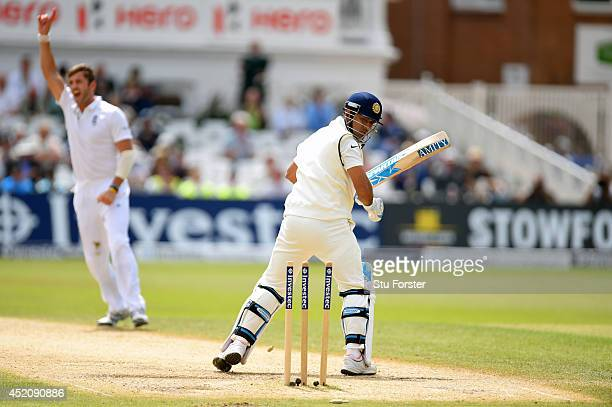India batsman Mahendra Singh Dhoni looks back at his stumps after being bowled by Liam Plunkett during day five of the 1st Investec Test Match...