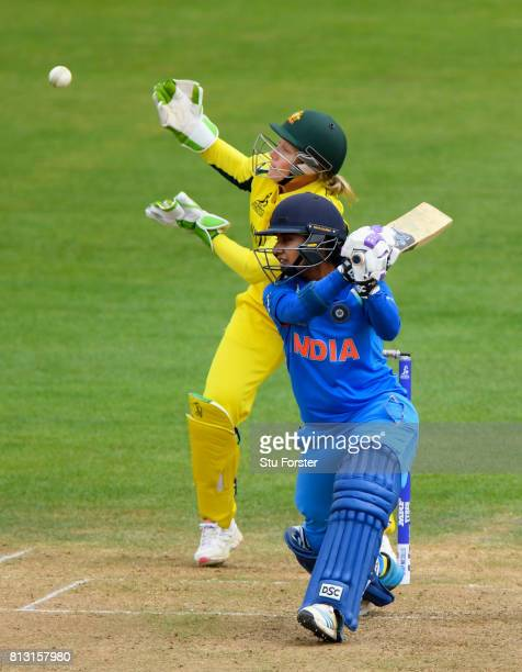 India batsman Mithali Raj edges a ball to the boundary watched by Australia wicketkeeper Alyssa Healy during the ICC Women's World Cup 2017 match...