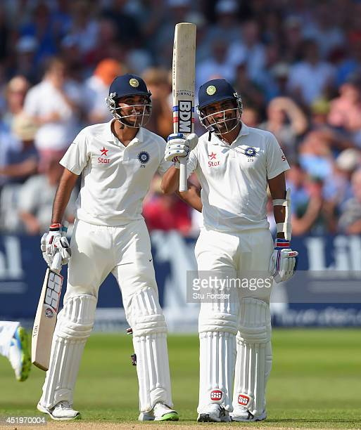 India batsman Mohammed Shami and partner Bhuvneshwar Kumar celebrate their 100 partnership for the last wicket and Shami's 50 which he had reached...