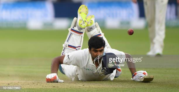 India batsman Ravi Ashwin looses his helmet as dives to make his ground during day 4 of the Second Test Match between England and India at Lord's...