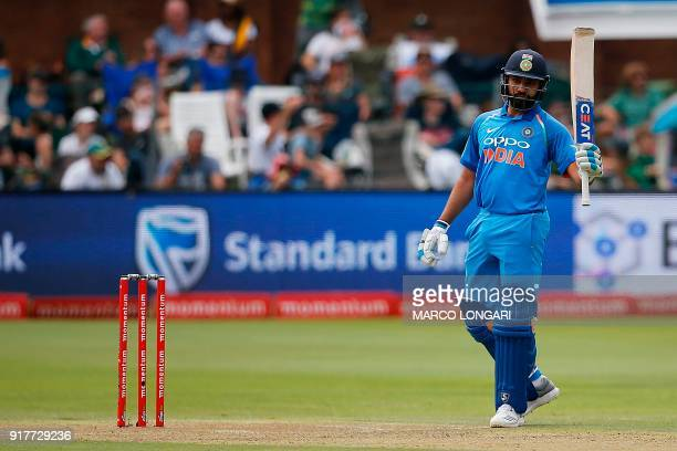 India batsman Rohit Sharma celebrates after scoring a half century during the fifth One Day International cricket match between South Africa and...