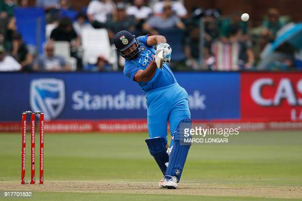 India batsman Rohit Sharma hits a four on a ball delivered by South Africa bowler Kagiso Rabada during the fifth One Day International cricket match...