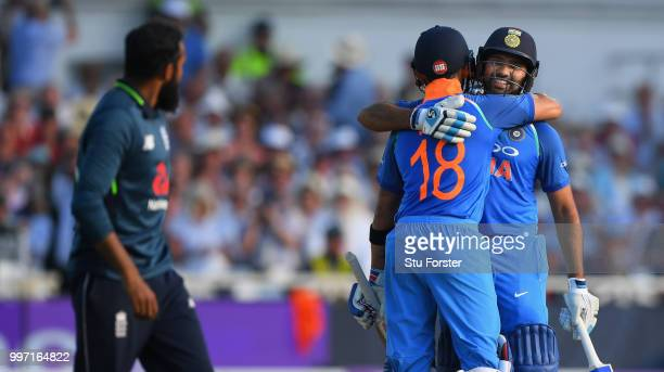 India batsman Rohit Sharma is congratulated by Virat Kohli after reaching his century during the 1st Royal London One Day International match between...