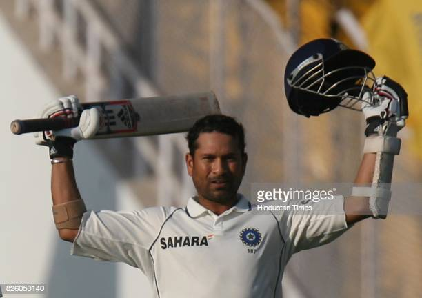 India batsman Sachin Tendulkar celebrates after his century on the fifth day of the first test match between India and Sri Lanka at Sardar Patel...