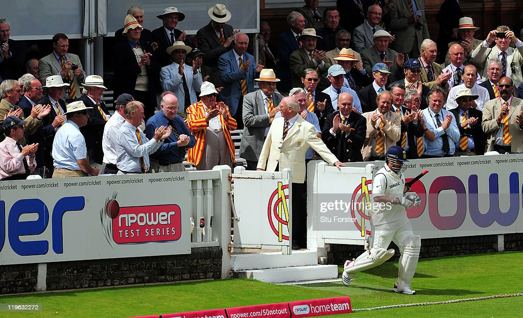 India batsman Sachin Tendulkar enters the field of play past the MCC members during day three of the 1st npower test match between England and India at Lords on July 23, 2011 in London, England.