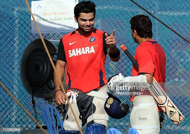 India batsman Sachin tendulkar talks with Virat Kohli after bowling in the nets during a team training session at Indian Institute of Technology...