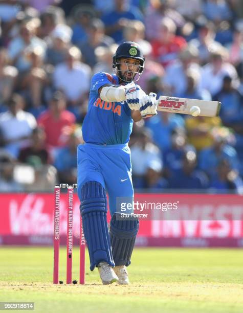 India batsman Shikar Dhawan pulls a ball to the boundary during the 2nd Vitality T20 International between England and India at Sophia Gardens on...