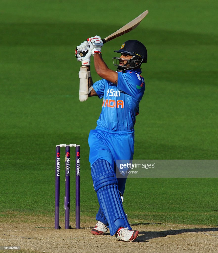 India batsman Shikhar Dhawan hits out during the NatWest T20 International between England and India at Edgbaston on September 7, 2014 in Birmingham, England.