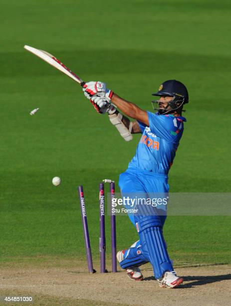 India batsman Shikhar Dhawan is bowled by Chris Woakes during the NatWest T20 International between England and India at Edgbaston on September 7,...