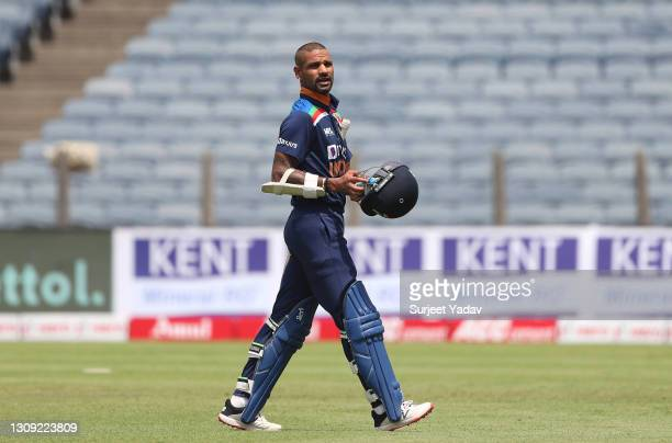India batsman Shikhar Dhawan leaves the field after being dismissed by Reece Topley for 4 runs during the 2nd One Day International between India and...