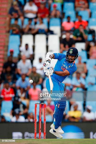 India batsman Shikhar Dhawan plays a ball delivered by South Africa bowler Morne Morkel during the sixth One Day International cricket match between...