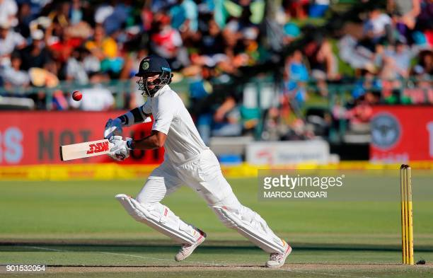 India batsman Shikhar Dhawan plays a shot during the first day of the first Test cricket match between South Africa and India at Newlands in Cape...