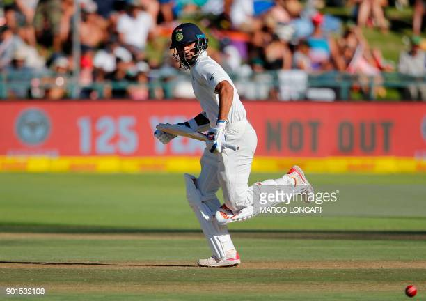 India batsman Shikhar Dhawan runs between the wickets after playing a shot during the first day of the first Test cricket match between South Africa...