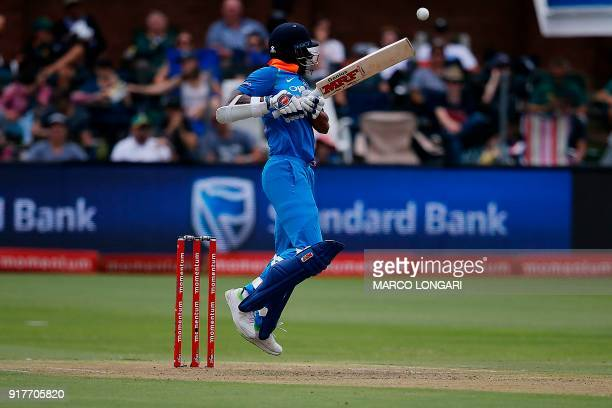 India batsman Shikhar Dhawan swings a ball delivered by South Africa bowler Kagiso Rabada during the fifth One Day International cricket match...