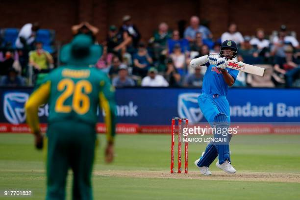 India batsman Shikhar Dhawan swings before being caught out on a ball delivered by South Africa bowler Kagiso Rabada during the fifth One Day...