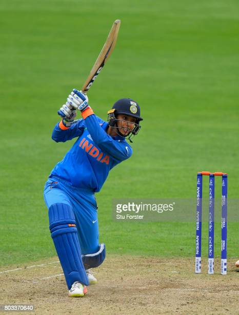 India batsman Smriti Mandhana reaches her century with a boundary during the ICC Women's World Cup 2017 match between West Indies and India at The...