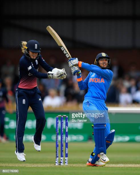 India batsman Smrti Mandhana hits a six watched by Sarah Taylor during the ICC Women's World Cup 2017 match between England and India at The 3aaa...
