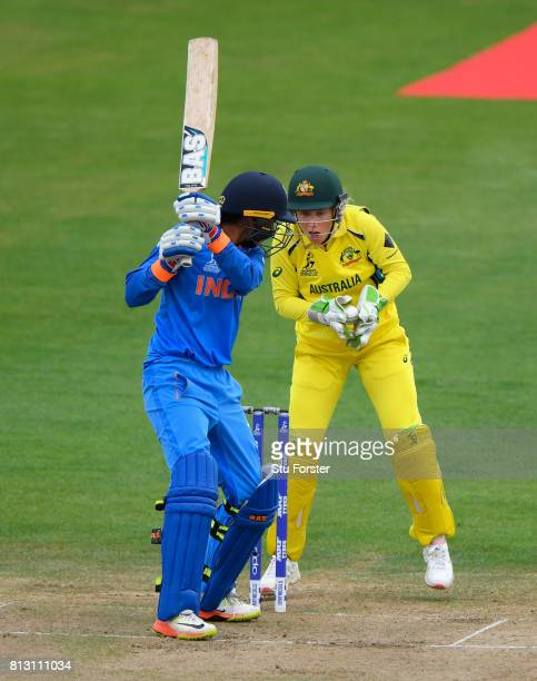India batsman Smrti Mandhana is caught by Australia wicketkeeper Alyssa Healy during the ICC Women's World Cup 2017 match between Australia and India...