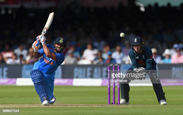 India batsman Suresh Raina hits out watched by Jos Buttler during the 2nd ODI Royal London One Day International match between England and India at...