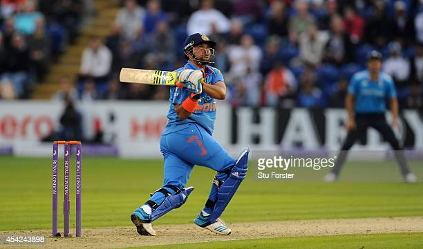 India batsman Suresh Raina hits six runs off England bowler Chris Woakes during the 2nd Royal London One Day International match between England and...