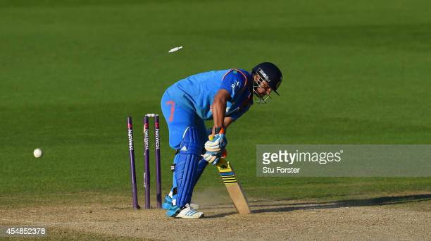 India batsman Suresh Raina is bowled by Harry Gurney during the NatWest T20 International between England and India at Edgbaston on September 7 2014...