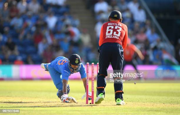 India batsman Suresh Raina is stumped by Jos Buttler during the 2nd Vitality T20 International between England and India at Sophia Gardens on July 6,...