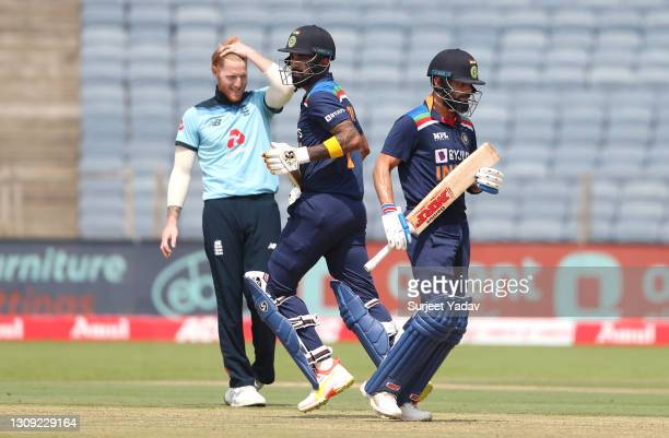 India batsman Virat Kohli and Kannaur Lokesh Rahul pick up runs whilst England bowler Ben Stokes reacts during the 2nd One Day International between...