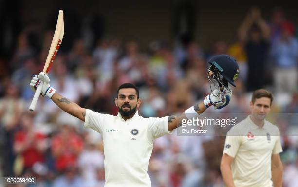 India batsman Virat Kohli celebrates reaching his century as bowler Chris Woakes looks on during day four of the 3rd Test Match between England and...