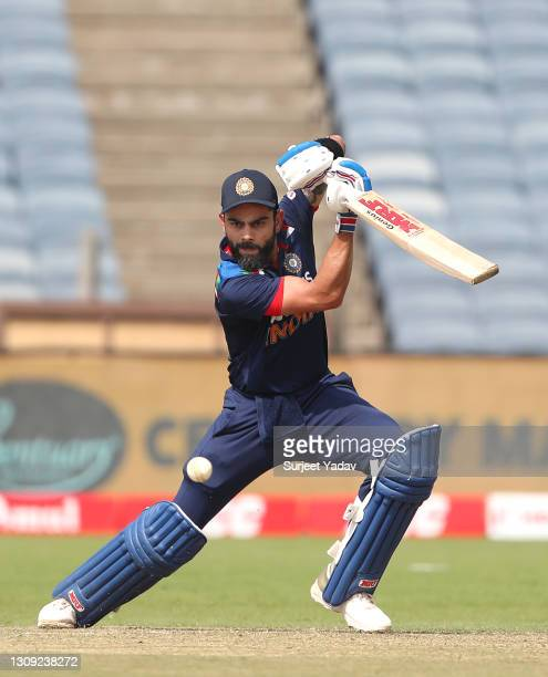 India batsman Virat Kohli cuts a ball for some runs during the 2nd One Day International between India and England at MCA Stadium on March 26, 2021...