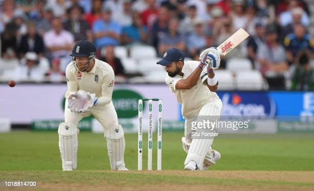 India batsman Virat Kohli drives watched by Jonny Bairstow is dismissed by Adil Rashid for 97 runs caught by Ben Stokes during day one of the 3rd...