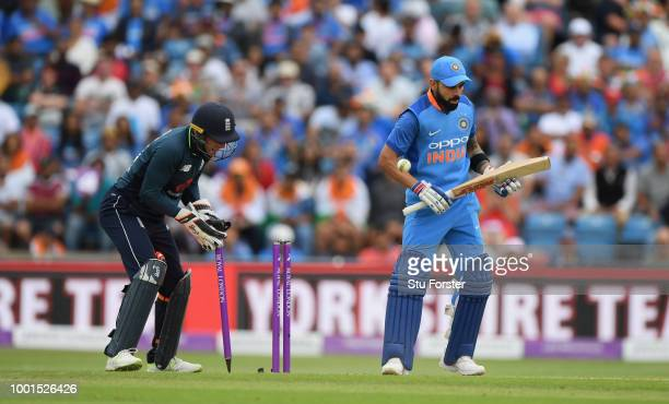 India batsman Virat Kohli reacts as Jos Buttler celebrates after Adil Rashid had bowled Kohli for 71 runs during 3rd ODI Royal London One Day match...