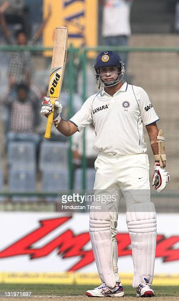 India batsman VVS Laxman raises his bat after scoring a halfcentury during the fourth day of the first test match between India and West Indies at...