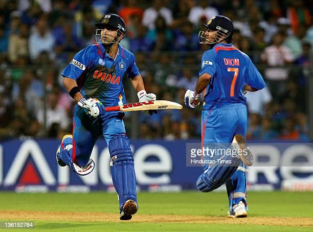 India batsmen Gautam Gambhir and Mahendra Singh Dhoni taking a run during the 2011 ICC World Cup final match between India and Sri Lanka at Wankhede...