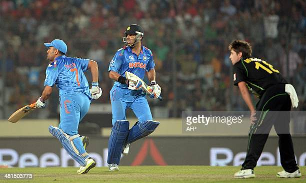 India batsmen Yuvraj Singh and Mahendra Singh Dhoni run between the wickets during the ICC World Twenty20 tournament cricket match between India and...