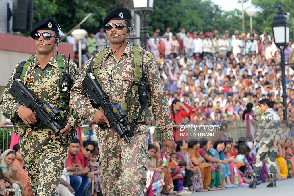 India Border Security force personnel patrol as they prepare for the flag off ceremony at IndiaPakistan Wagah Border Post on July 9 2013 In a...