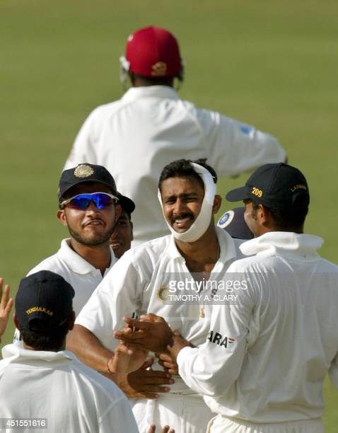 India bowler Anil Kumble is hugged by his teammates after bowling out West Indies Brian Lara during the 2002 forth Test Match Cricket Series 12 May...