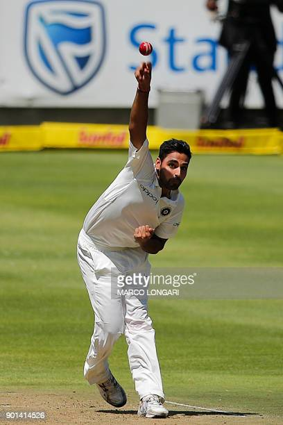 India bowler Bhuvneshwar Kumar delivers a ball during Day One of the First Test cricket match between South Africa and India at Newlands cricket...