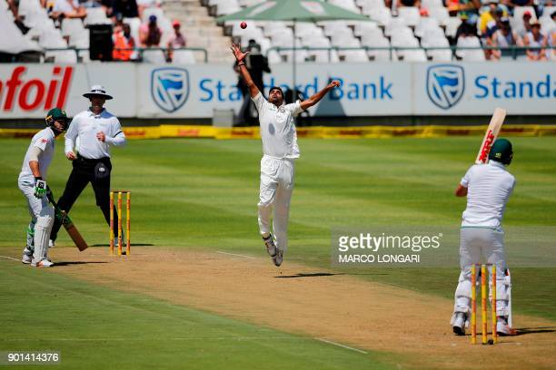 India bowler Bhuvneshwar Kumar stretches to reach a ball during Day One of the First Test cricket match between South Africa and India at Newlands...
